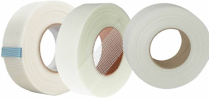 Three rolls of fiberglass drywall joint tape in white color
