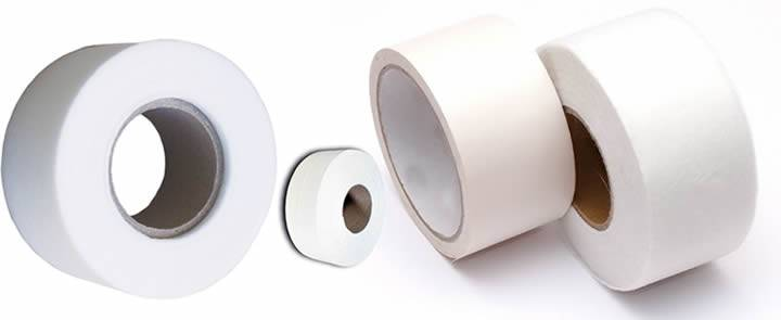 Four rolls of white Non-woven fiberglass tape